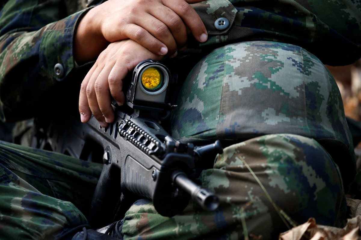 A soldier holds his weapon during the Cobra Gold multilateral military exercise in Chanthaburi, Thailand