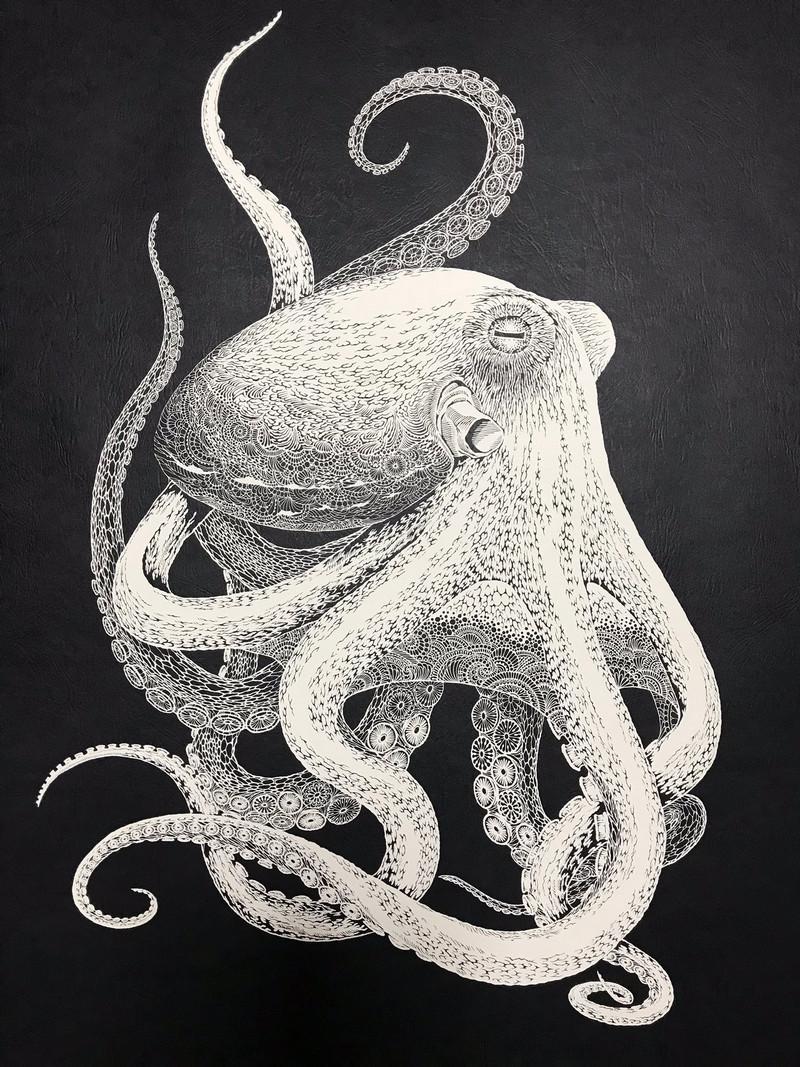 Тонкое японское искусство – осьминог_ вырезанный из одного листа бумаги 1
