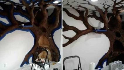 Мужчина завоевал кошачье сердце, соорудив громадное дерево в доме